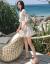 若くて柔らかい半袖チョコのワンピス2019夏の新商品の女装小清新な中、长めのラッパの袖の学生は复古の小柄な花の休暇を过ごしました。短い砂浜のスカウトの小花S